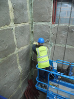 Martin fitting the Bendcrete Panels at Bolton One